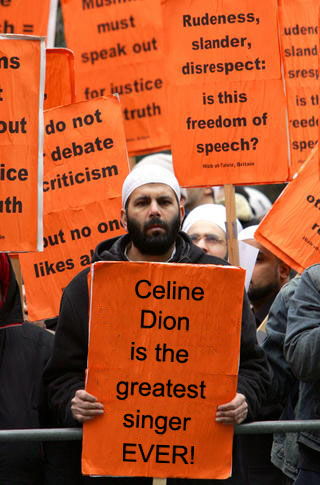 Protester defends Celine Dion from Troy Lukkarila.